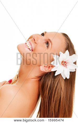 portrait of beautiful cheery woman with flower in her hair