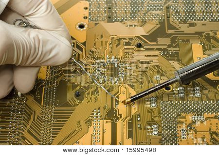 Expert Is Repairing Motherboard