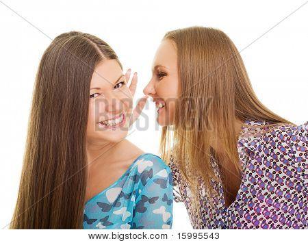 cheerful girls speaking. isolated on white