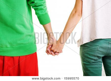 couple of teenagers holding hands against white background