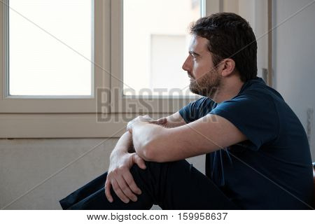 Sad Man Portrait Looking Out Of The Window