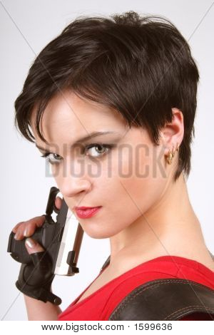 Brunette With Pistol