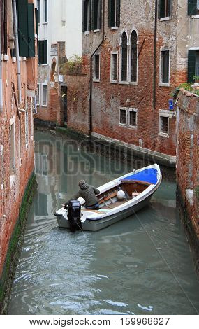 The Narrow Water Canal In Venice