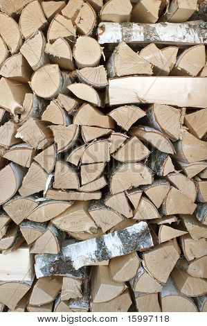 Birch Logs Are Stacked In Woodpile