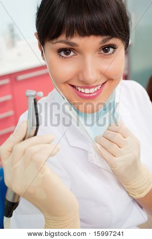 portrait of beautiful doctor with dental's instrument