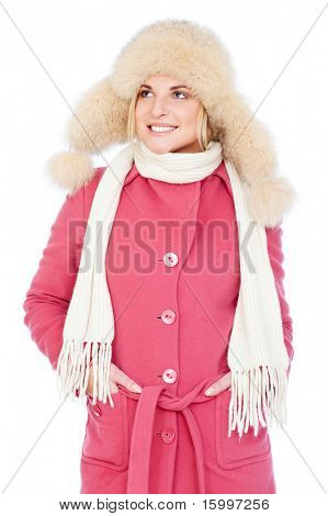 portrait of smiley woman in pink coat and fur hat. isolated on white background