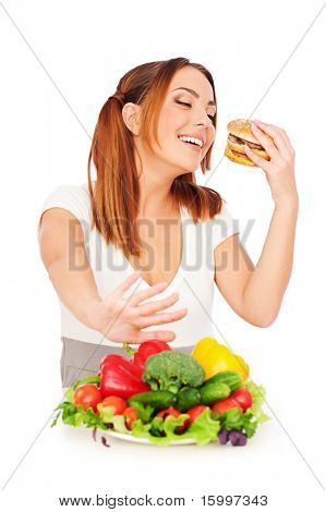 portrait of woman with tasty burger and vegetables. isolated on white