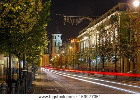 Gediminas prospect and Cathedral Belfry and luminous track from the car at night, Vilnius, Lithuania, Baltic states.