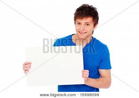 portrait of handsome young man holding blank billboard over white background