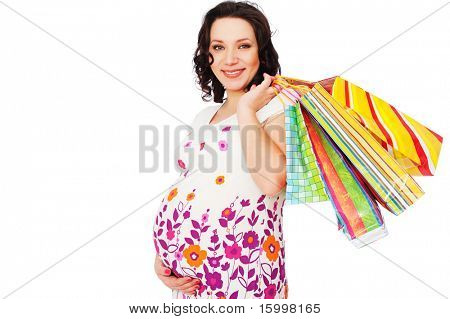smiley pregnant woman holding shopping bags. isolated on white
