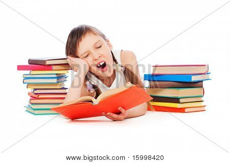 portrait of drowsy little girl with books