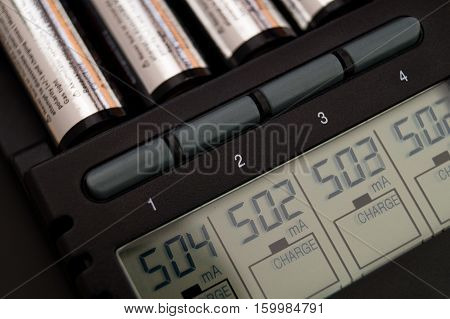 AA / AAA Battery Charger for (Ni-Mh) and (Ni-Cd) rechargeable batteries with lcd display and showing charging current
