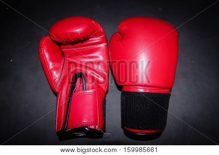 The red boxing Gloves on black background