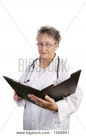 Mature Female Doctor Reviewing Chart