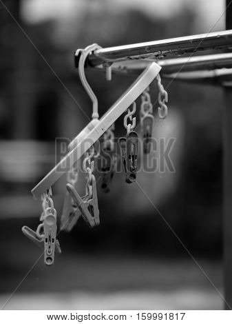 BLACK AND WHITE PHOTO OF CLOTHES PEGS