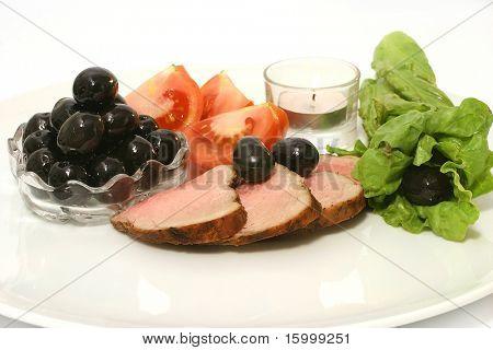 roast meat and black olives