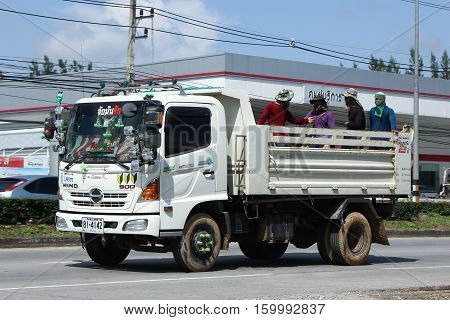 CHIANG MAI THAILAND - OCTOBER 28 2016: Private Hino Dump Truck with Passenger in Dump Cargo. Photo at road no.1001 about 8 km from downtown Chiangmai thailand.