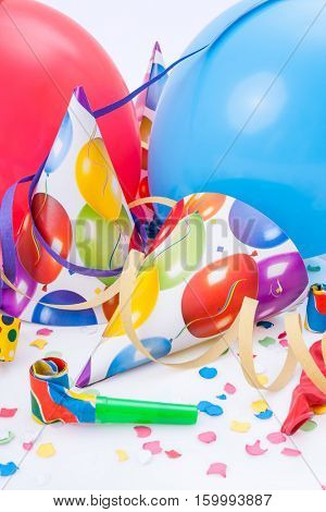 New Year party, celebration or festivity with party hats, horns, whistles or noisemakers, balloons, confetti and streamers