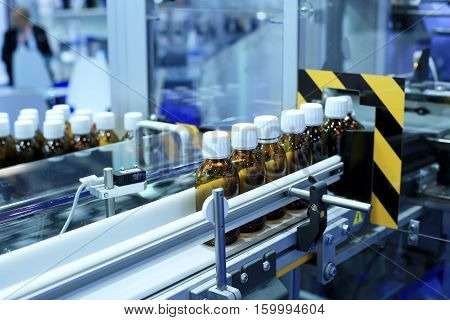 Factory for the production of medicines, glass bottles on the conveyor