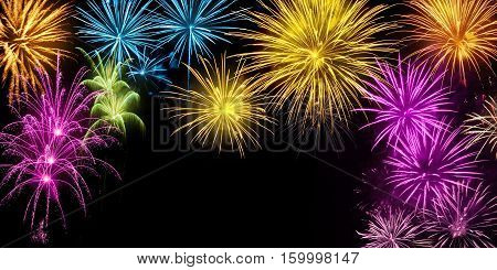 Gorgeous multi-colored fireworks on black background with copy space ideal for New Year or other celebration events