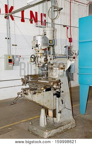DAYTON, OHIO, USA - NOVEMBER 18, 2016: A Bridgeport milling machine in the Restoration Hanger of the National Museum USAF is used in metal millwork to restore aircraft & related items.