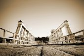 stock photo of old bridge  - Low angle sepia shot of old bridge - JPG