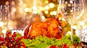 Christmas table setting with turkey. Christmas dinner. Holiday decorated table, Christmas tree, cham poster