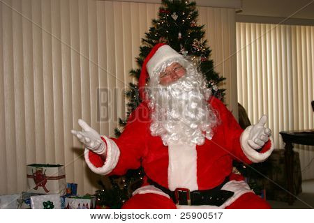 Santa relaxes by a xmas tree