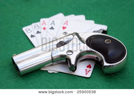 "Circa 1889, Model 95, Type II Model 3 Double Derringer on card table with aces and eights aka a ""Dead Mans Hand"""