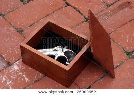 ââ?¬Å?Circa 1889, Model 95, Type II Model 3 Double Derringerââ?¬Â lays inside its carring case on a brick ground