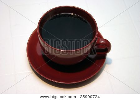 Large Cup and Saucer of fresh brewed coffee black