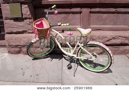 colorful lone bicycle with a basket