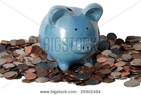 Isolated piggy bank on a pile of change