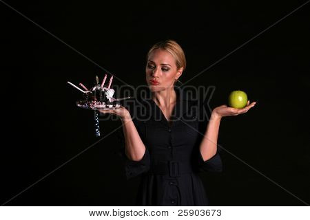 an attractive fit blondie must decide to eat cake or an apple