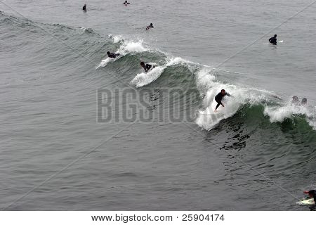 surfers ride the waves in Huntington Beach California aka Surf City