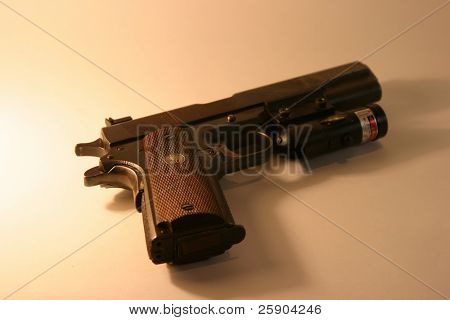 """1911 A1 Colt """".45 ACP"""" Pistol with a Laser Site attached"""