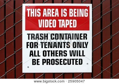 """this area is being VIDEO TAPED"" ""trash container"" ""for tenants only"" ""all others will be prosecuted"""