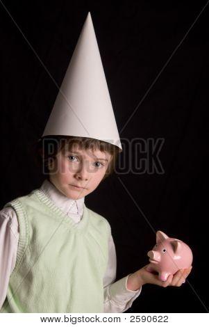 Dunce Cap And Piggybank