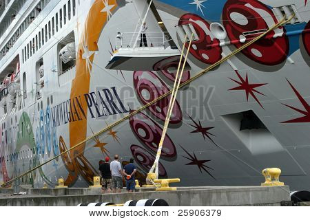 workers prepair for departure of a  cruise ship in seattles puget sound