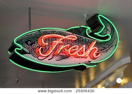 "neon sign series ""fresh"" fish sign in green and pink neon"