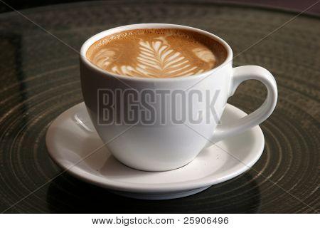 "a latte with ""latte art"" in foam in a ceramic cup in seattles world famous pike place market aka farmers market"