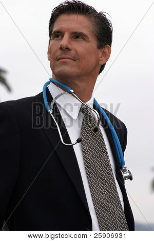 a doctor or surgeon or veterinarian, stands proud of his accomplishments and his accomplishments in society concepts