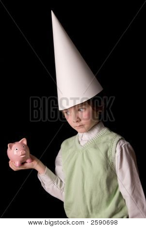 Dunce Cap And Piggybank