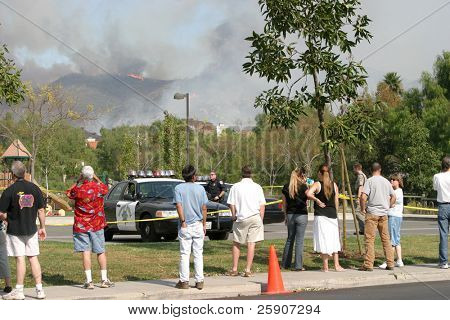 on the Portilla Hills side people can watch the devastating wild fires engulf Santiago Canyon destroying Homes, Property and anything in its way