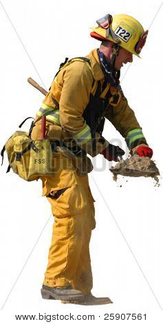 isolated fireman on white using a shovel of dirt to put out a small fire