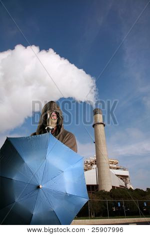 a man in a gas mask opens a blue umbrella in front of a power plant with its smoke stack pumping out global warming gases into the atmosphere and causing acid rain