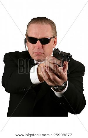Isolated on white CIA or Secret Service man pointing a gun in YOUR GENERAL DIRECTION