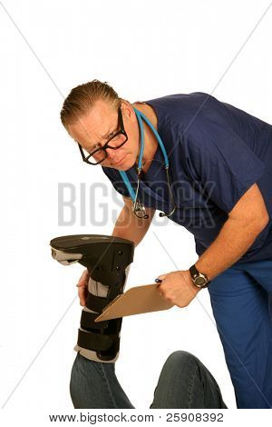 A Handsome and friendly doctor examins his patients hurt leg and foot