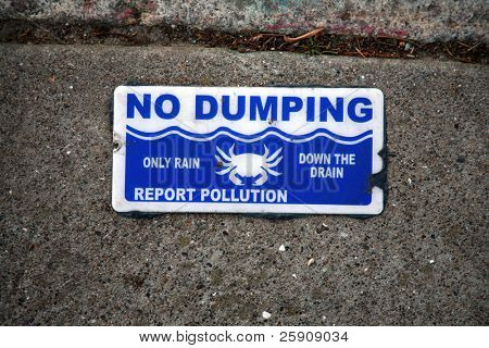 """no dumping"" ""drains to the bay"" pollution warning sign on a sidewalk"