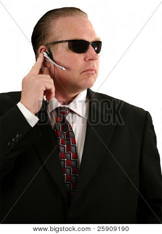 "a Secret Service Agent talks into his microphone  ""isolated on white"""